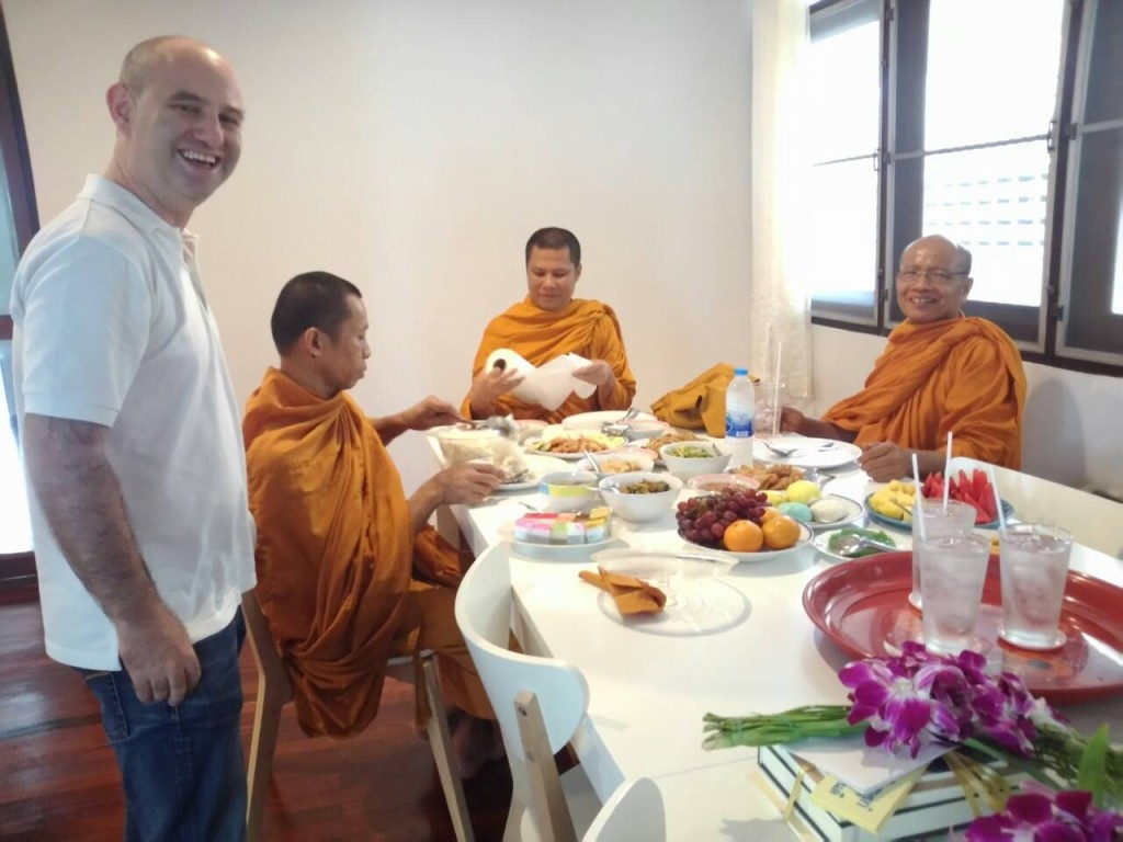 Offering lunch to monks at Expique's Tamboon Baan