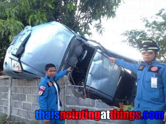 A scene from an incident in the media in Thailand, with men pointing at an overturned car - photo via ThaisPointingAtThings.com
