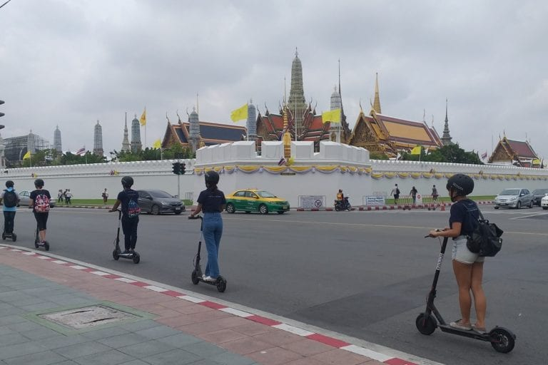 Riding an eScooter passed the Grand Palace