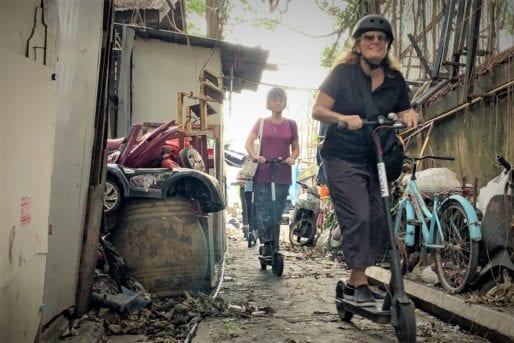 Riding eScooters along Bangkok Backstreets