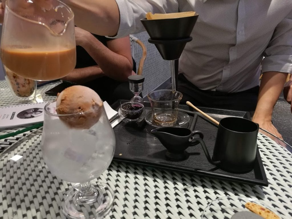 Pour-over tea served with ice cream in a mall shop